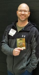 Photo of Dan Weaver with raffle prize